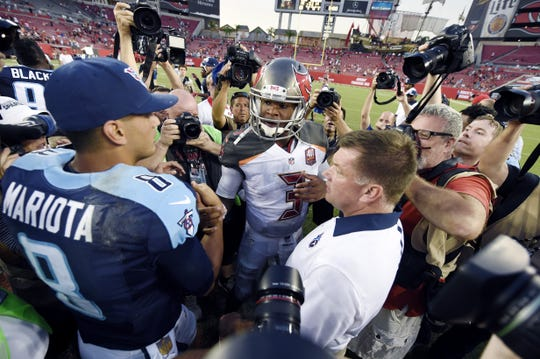 Tennessee Titans quarterback Marcus Mariota (8) meets Tampa Bay Buccaneers quarterback Jameis Winston (3) midfield following the Titans 42-14 victory over the Tampa Bay Buccaneers at Raymond James Stadium in Tampa, Fla. Sept. 13, 2015.