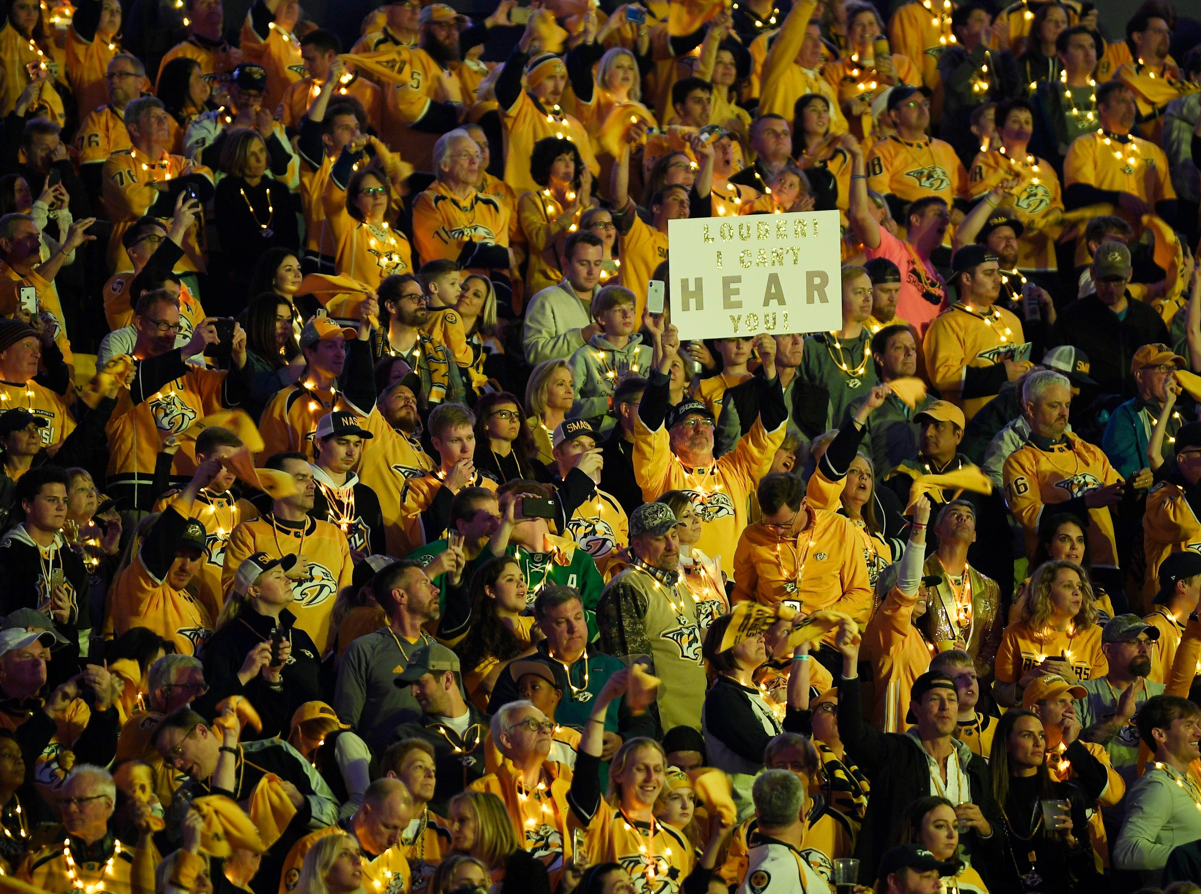 Predators fan cheer during the first period of the divisional semifinal game at Bridgestone Arena in Nashville, Tenn., Saturday, April 13, 2019.