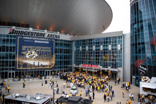 Fans enter before the Nashville Predators game against the Dallas Stars at Bridgestone Arena Saturday, April 13, 2019, in Nashville, Tenn.