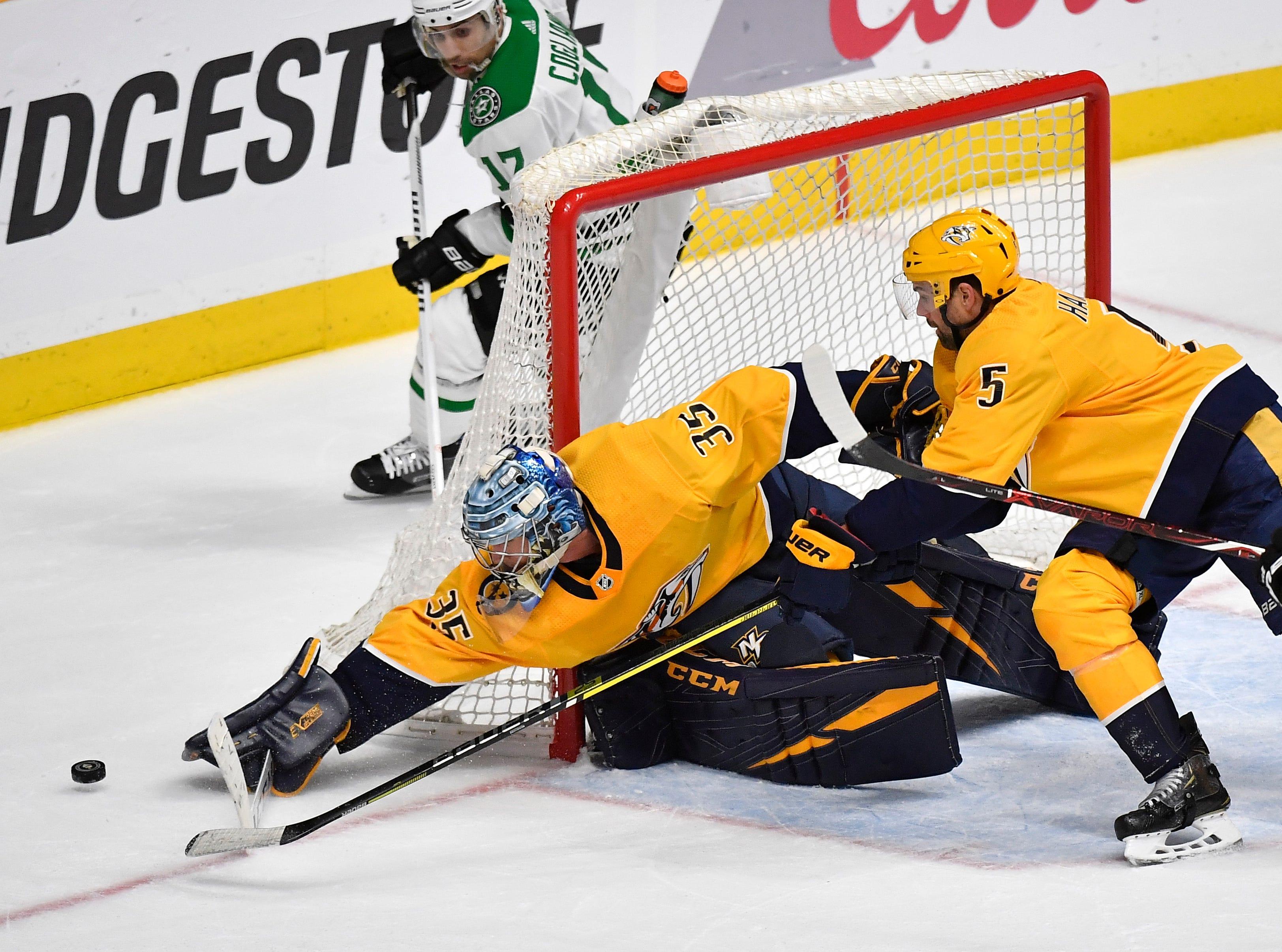 Nashville Predators goaltender Pekka Rinne (35) plays the puck wide during the first period of the divisional semifinal game at Bridgestone Arena in Nashville, Tenn., Saturday, April 13, 2019.