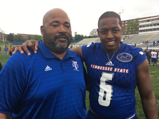 Christion Abercrombie, right, who suffered a severe brain injury in a game last season, with Tennessee State Coach Rod Reed. Abercrombie has made a remarkable recovery and was able to attend the Tigers' spring game Saturday at Hale Stadium.