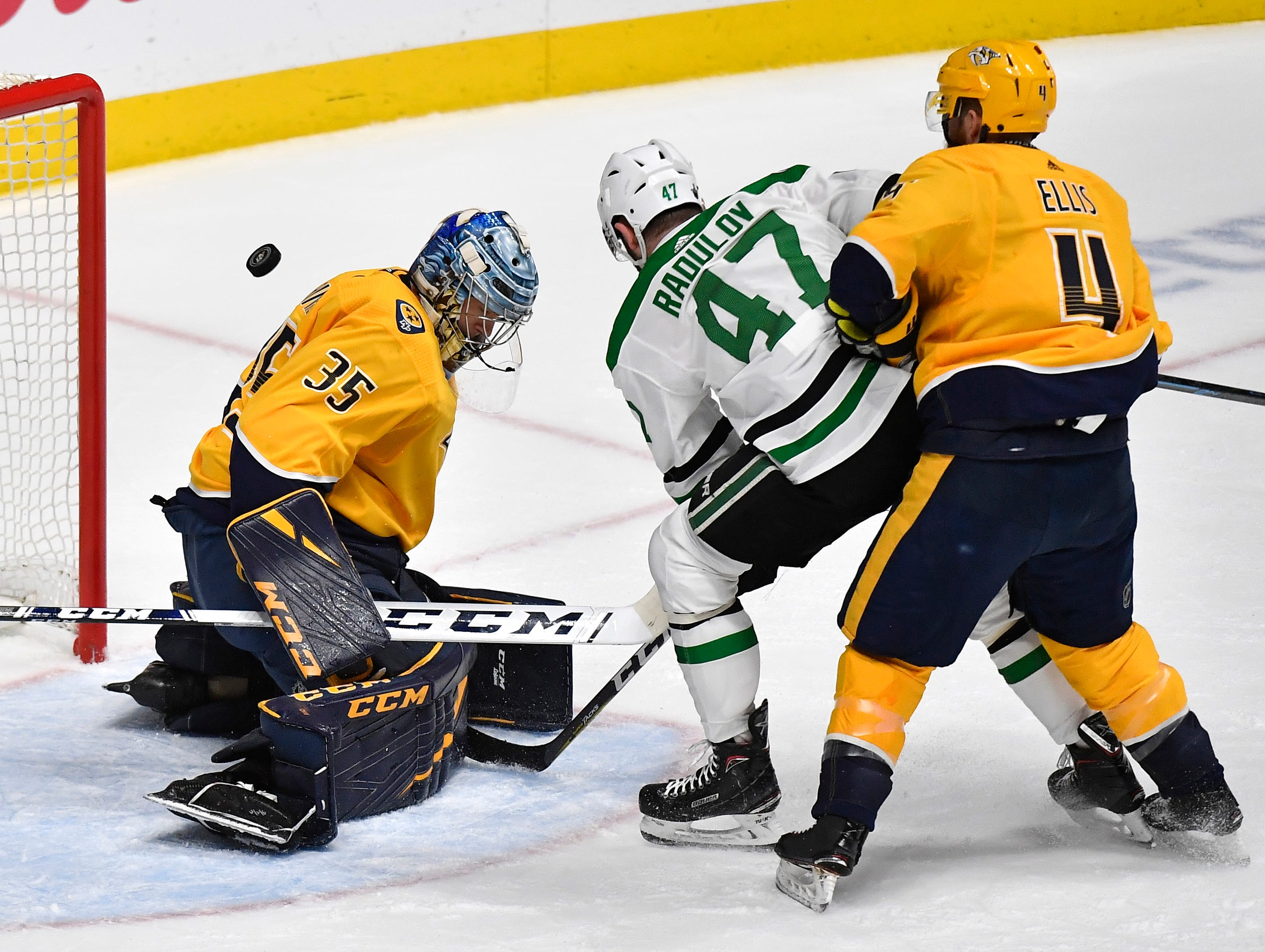 A Dallas shot goes wide of Nashville Predators goaltender Pekka Rinne (35) with Dallas Stars right wing Alexander Radulov (47) and Nashville Predators defenseman Ryan Ellis (4) in front of the net during the first period of the divisional semifinal game at Bridgestone Arena in Nashville, Tenn., Saturday, April 13, 2019.