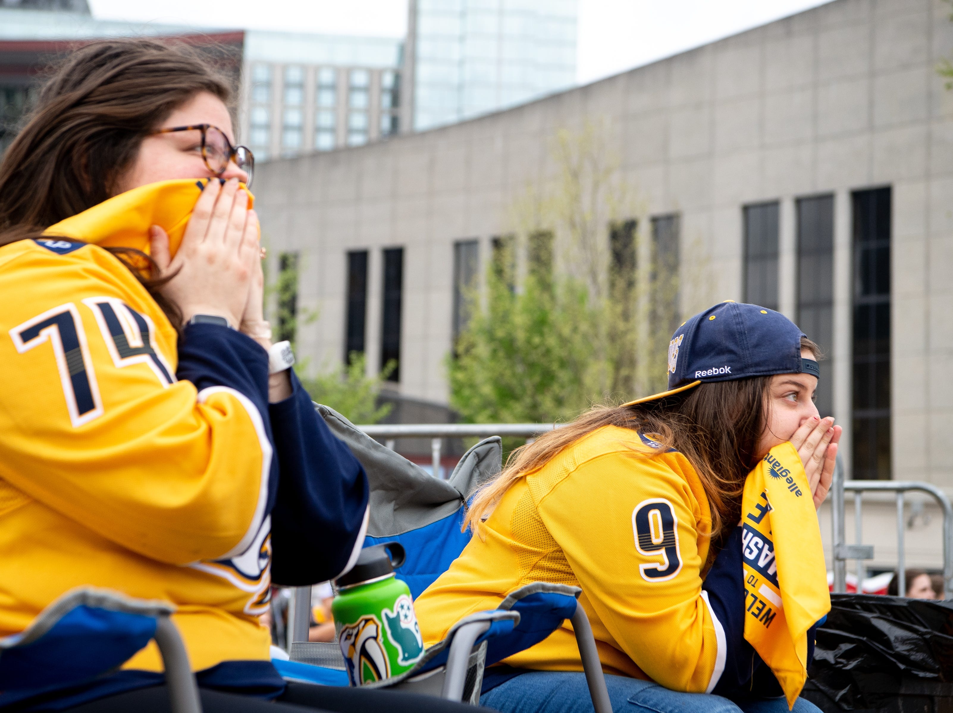 Sisters Kelly and Sophia Campbell watch the first period of the Nashville Predators game against the Dallas Stars at Preds Party in the Park at Walk of Fame Park Saturday, April 13, 2019, in Nashville, Tenn.