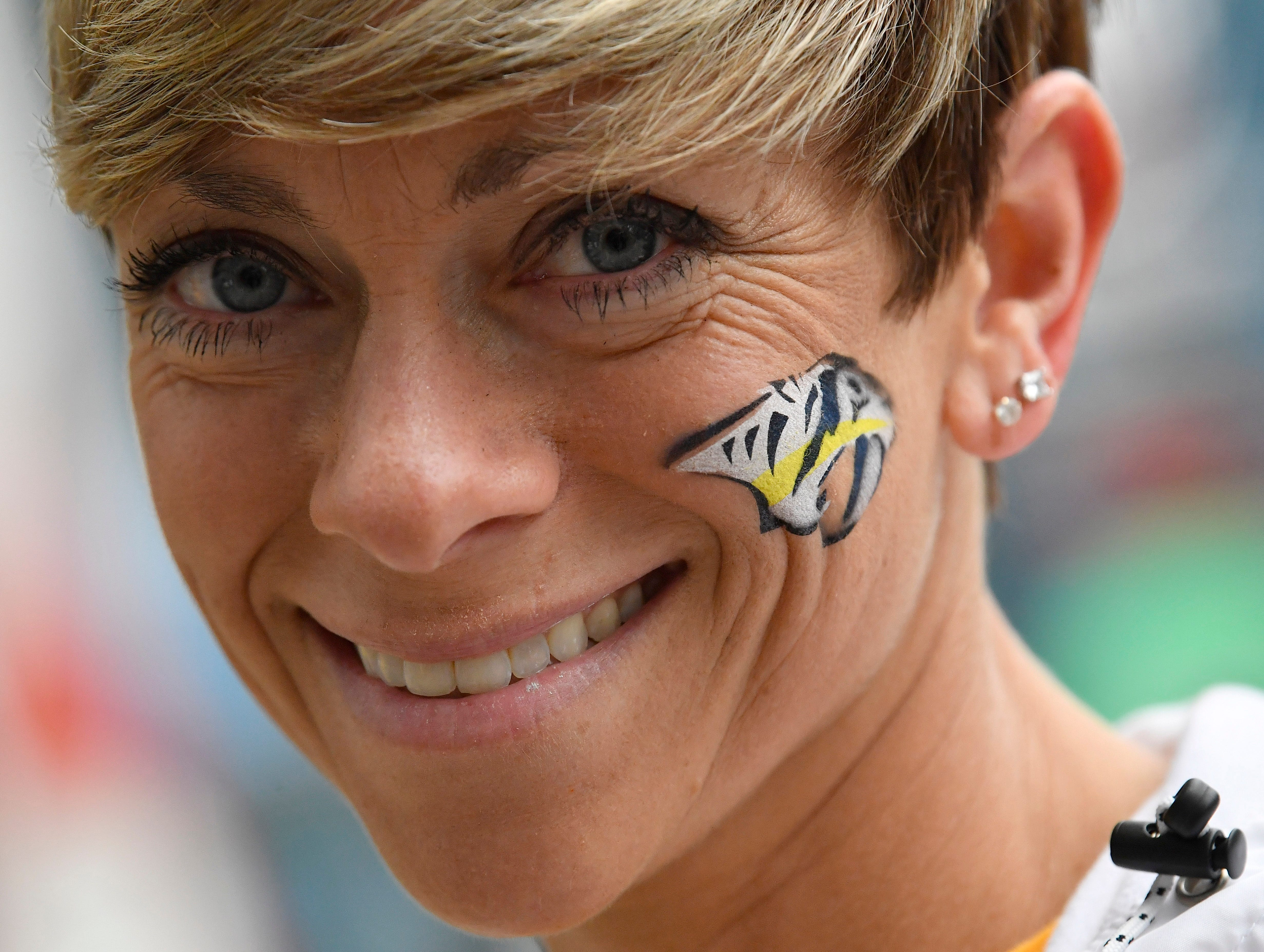 Angela Garton wears her Predators support on her face before the divisional semifinal game against Dallas at Bridgestone Arena in Nashville, Tenn., Saturday, April 13, 2019.