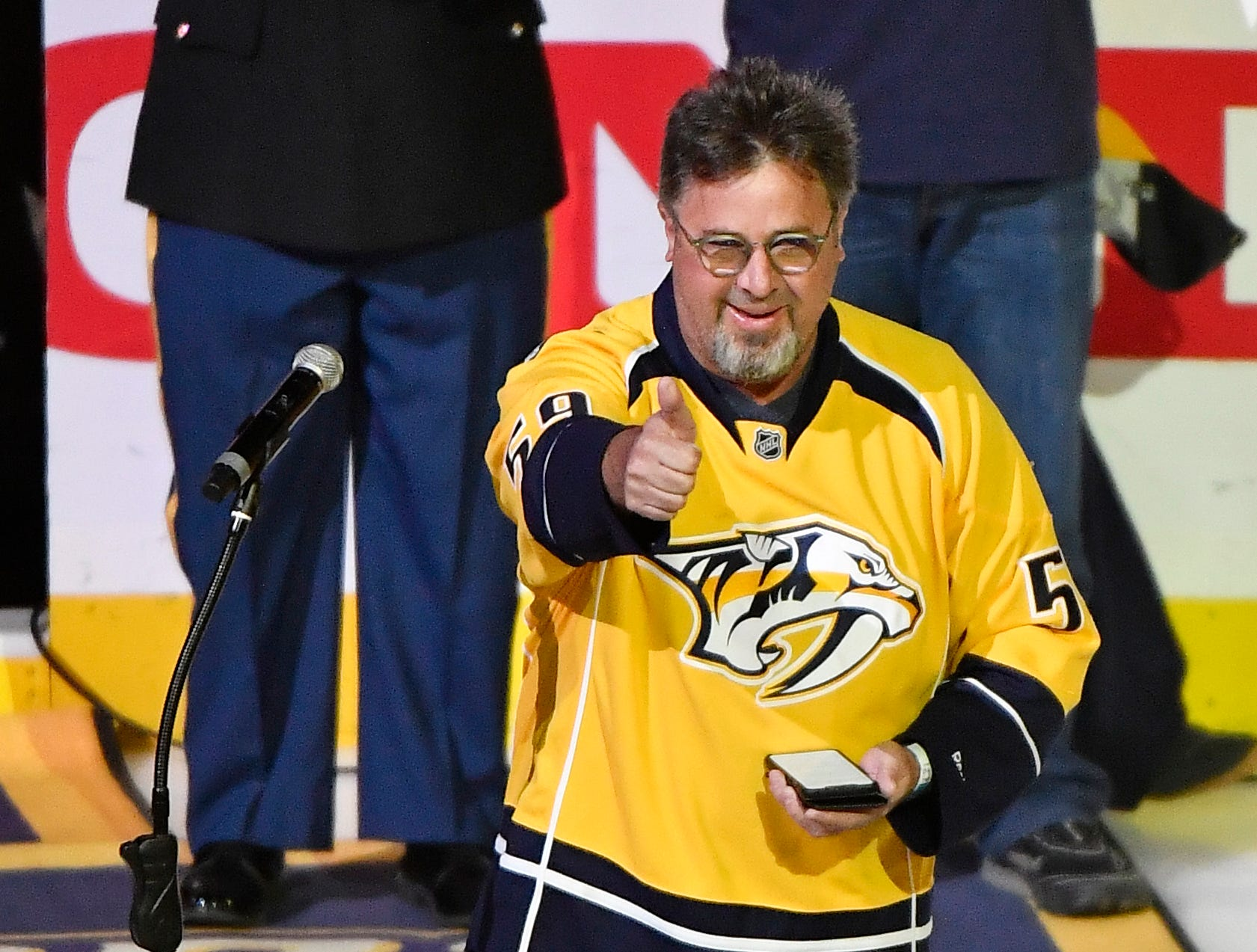 Vince Gill gestures after singing the national anthem before the Predators' divisional semifinal game against the Stars at Bridgestone Arena in Nashville, Tenn., Saturday, April 13, 2019.
