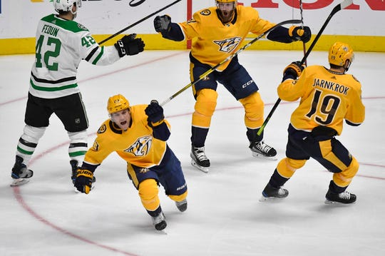 Nashville Predators center Rocco Grimaldi (23) celebrates his first career playoff goal with left wing Austin Watson (51) and center Calle Jarnkrok (19) during the second period Saturday at Bridgestone Arena. The goal tied the game, which the Predators would go on to win 2-1 in overtime.