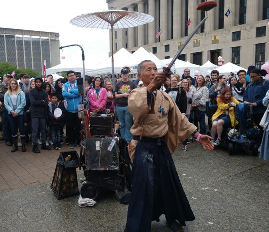 Masaji Terasawa performs for a crowd of onlookers during the Nashville Cherry Blossom Festival on Saturday at One Public Square.