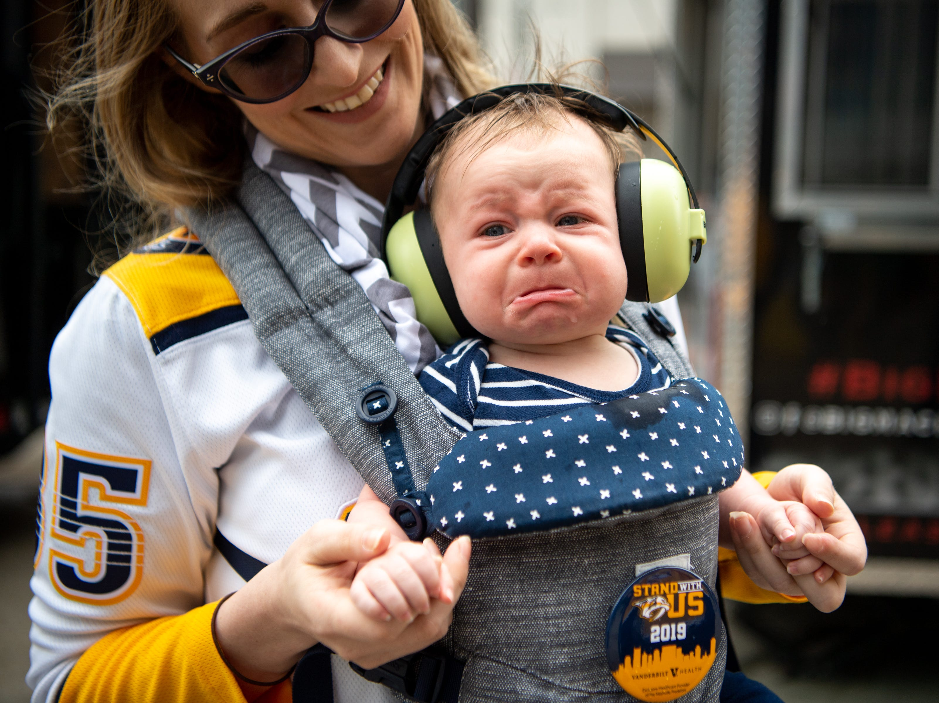 Arvid, 4 months, cries while being held by his mother Andrea Borg before the Nashville Predators game against the Dallas Stars at Bridgestone Arena Saturday, April 13, 2019, in Nashville, Tenn.