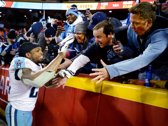 Tennessee Titans running back Derrick Henry (22) celebrates with Titans fans after defeating the Chiefs 22-21 at Arrowhead Stadium Jan. 6, 2018 in the AFC Wild Card playoff game.