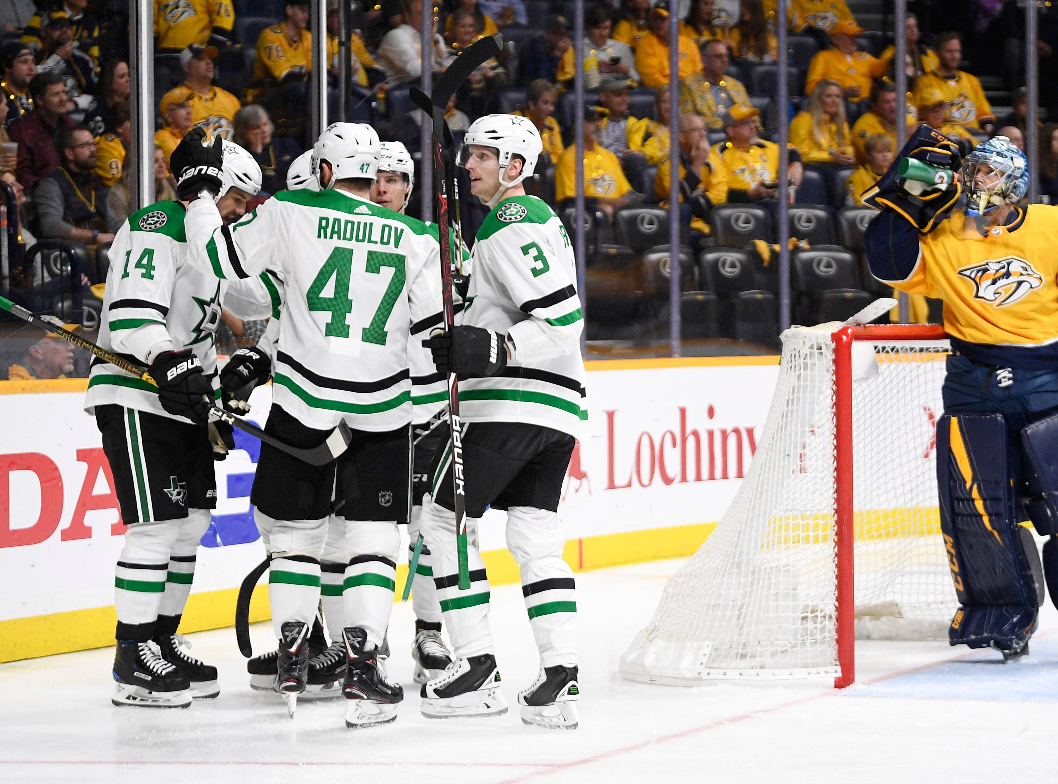 The Stars celebrate the goal by Dallas Stars left wing Jamie Benn (14) as Nashville Predators goaltender Pekka Rinne (35) takes a drink during the second period of the divisional semifinal game at Bridgestone Arena in Nashville, Tenn., Saturday, April 13, 2019.