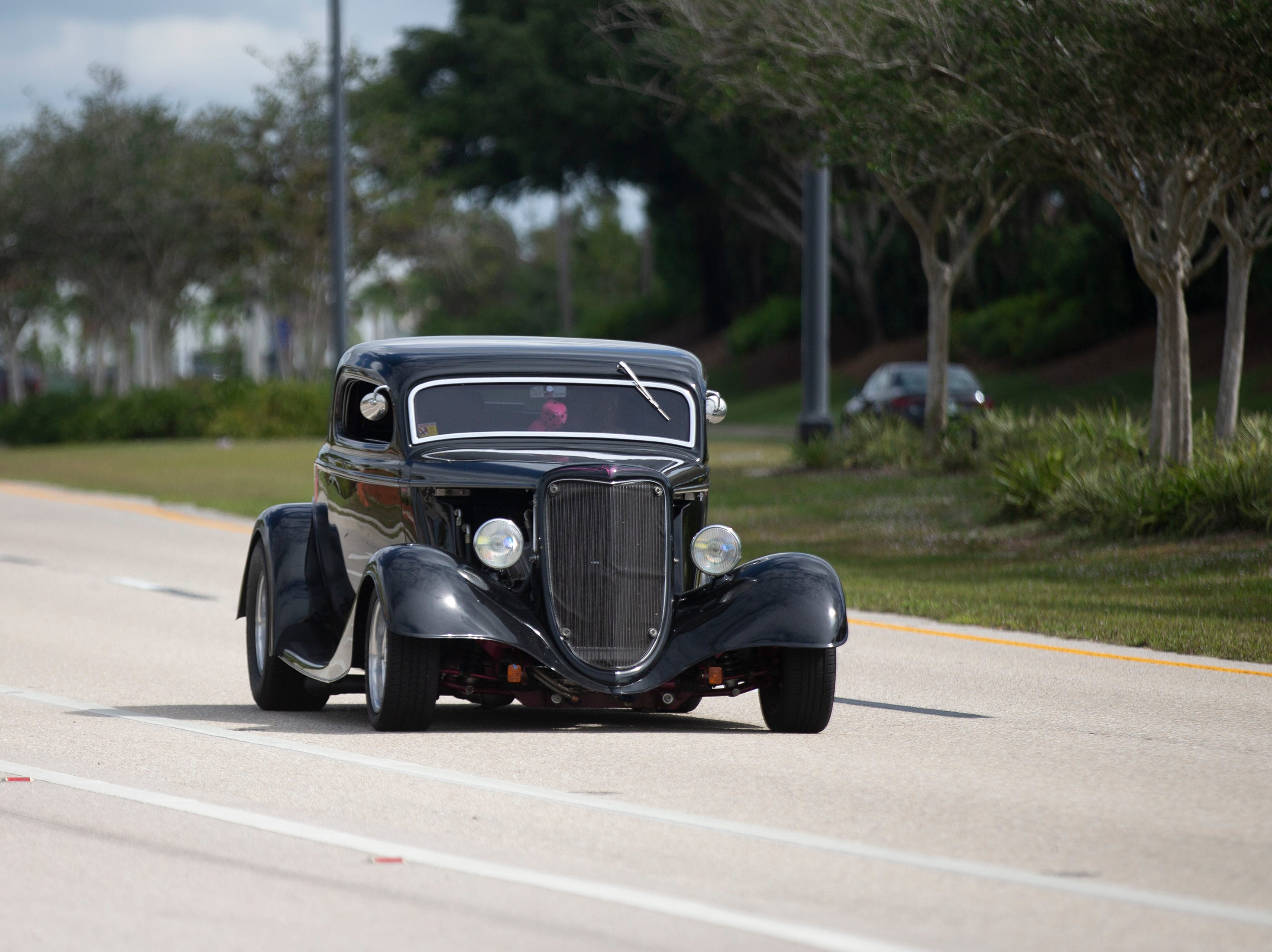 A car participates in the Cruis'n for a Cause event on Saturday, April 13, 2019 in Estero.