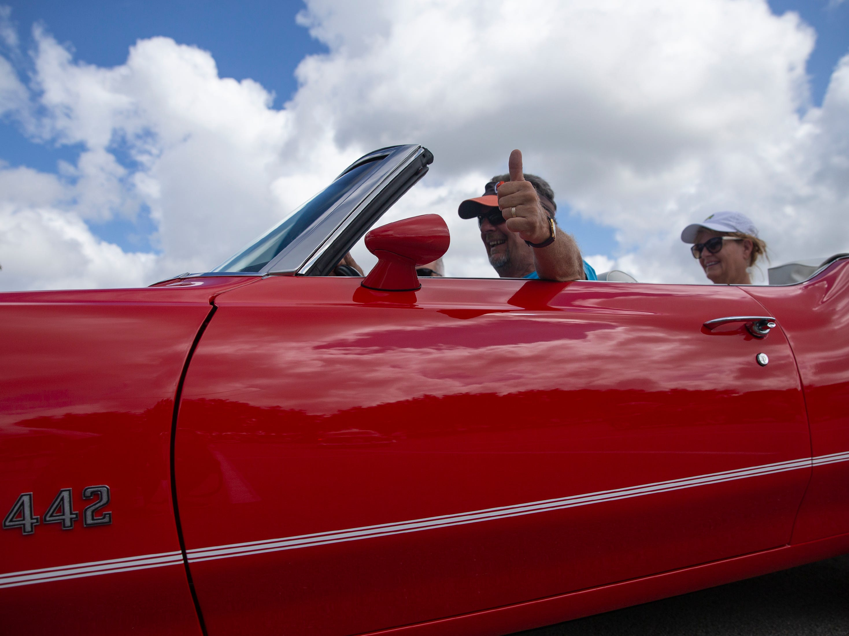 Cape Coral residents Paul Perzyk drives Terri Smith's, pictured in the back seat, 1971 Oldsmobile 442 during the Cruis'n for a Cause event on Saturday, April 13, 2019 at the Miromar Outlets in Estero.