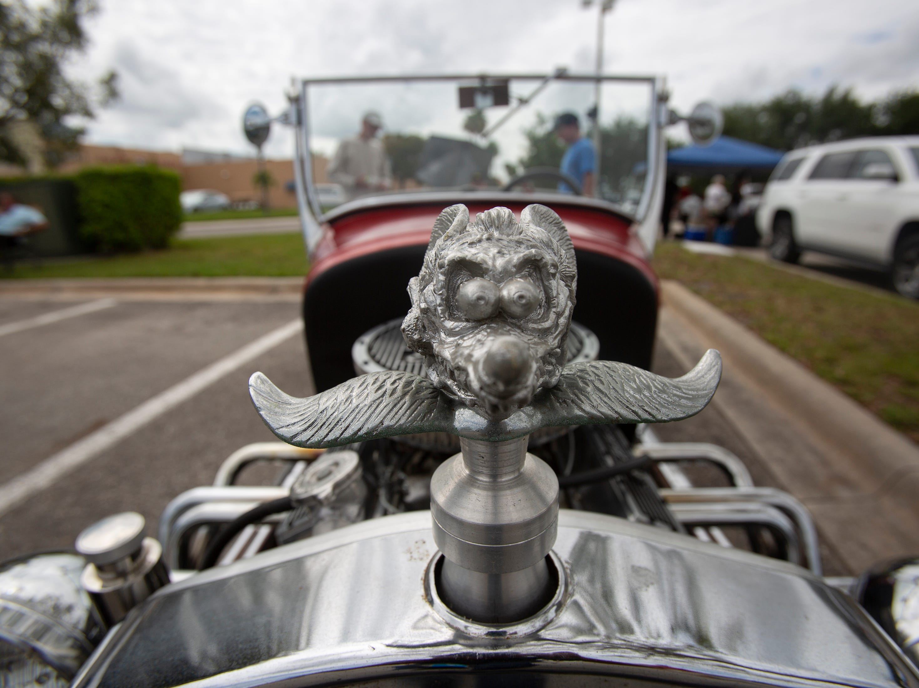 The hood ornament of 'Rat Fink' sits up front on Estero resident Ray Frank's 1927 replica Ford Model T during the Cruis'n for a Cause event on Saturday, April 13, 2019 at the Miromar Outlets in Estero.