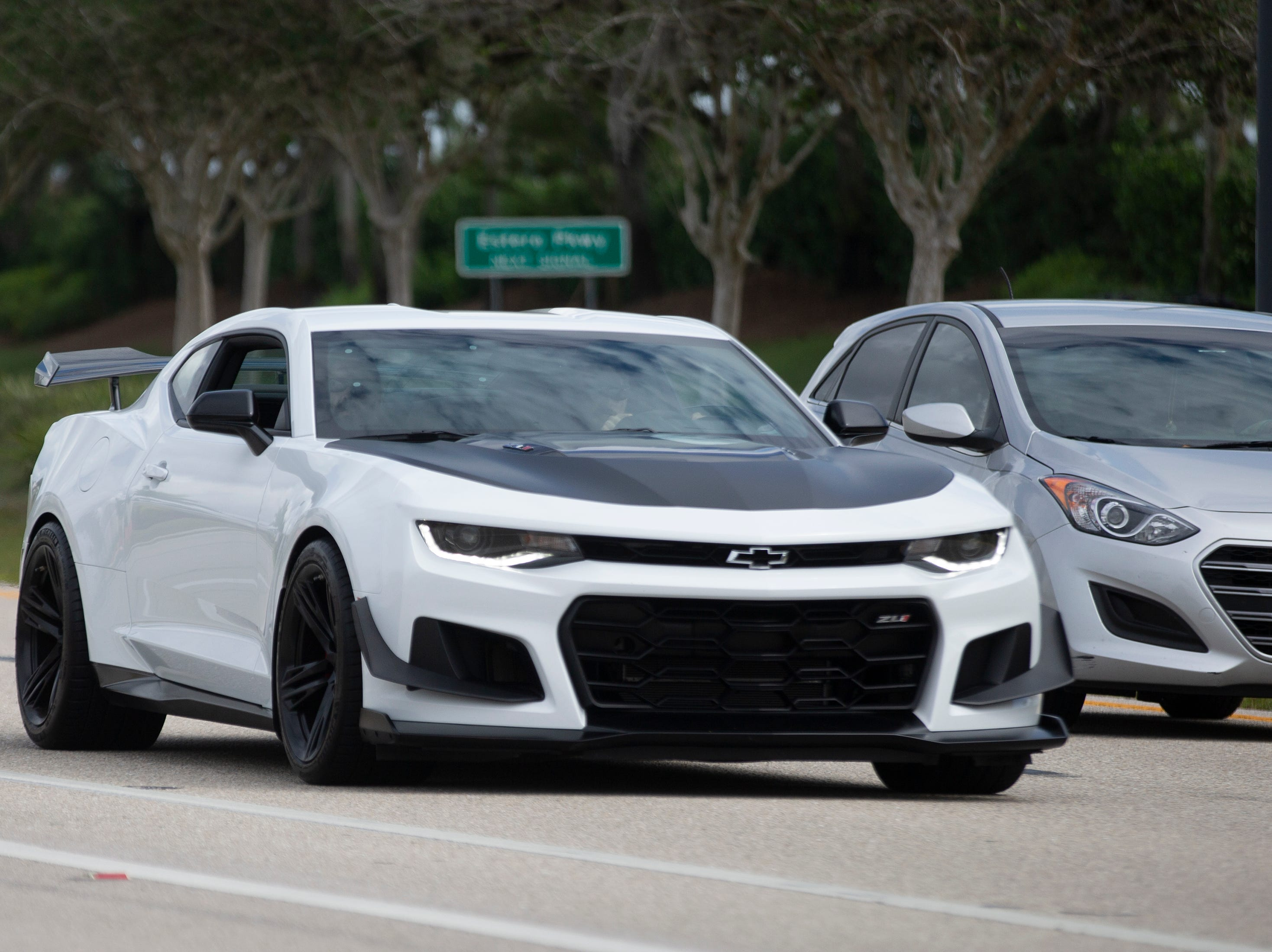 Cars make their way down Ben Hill Griffin Parkway during the Cruis'n for a Cause event on Saturday, April 13, 2019 in Estero.