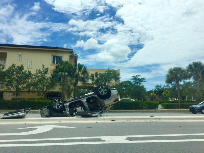 An overturned vehicle is seen on Pine Ridge Road near U.S. 41 around 1 p.m. on Saturday, April 13, 2019.