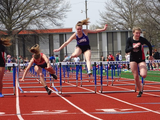 Granville Christian junior Avery Adkins, middle, competes in the 100 hurdles during Saturday's Lakewood Invitational.