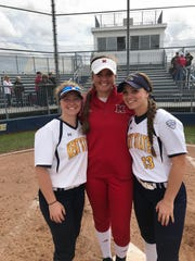 Kent State sisters Bailey (left) and Brenna Brownfield flank Miami of Ohio pitcher and former Lakewood teammate Courtney Vierstra, after they teamed up to help the Golden Flashes beat the visiting Red Hawks 3-0 Friday.