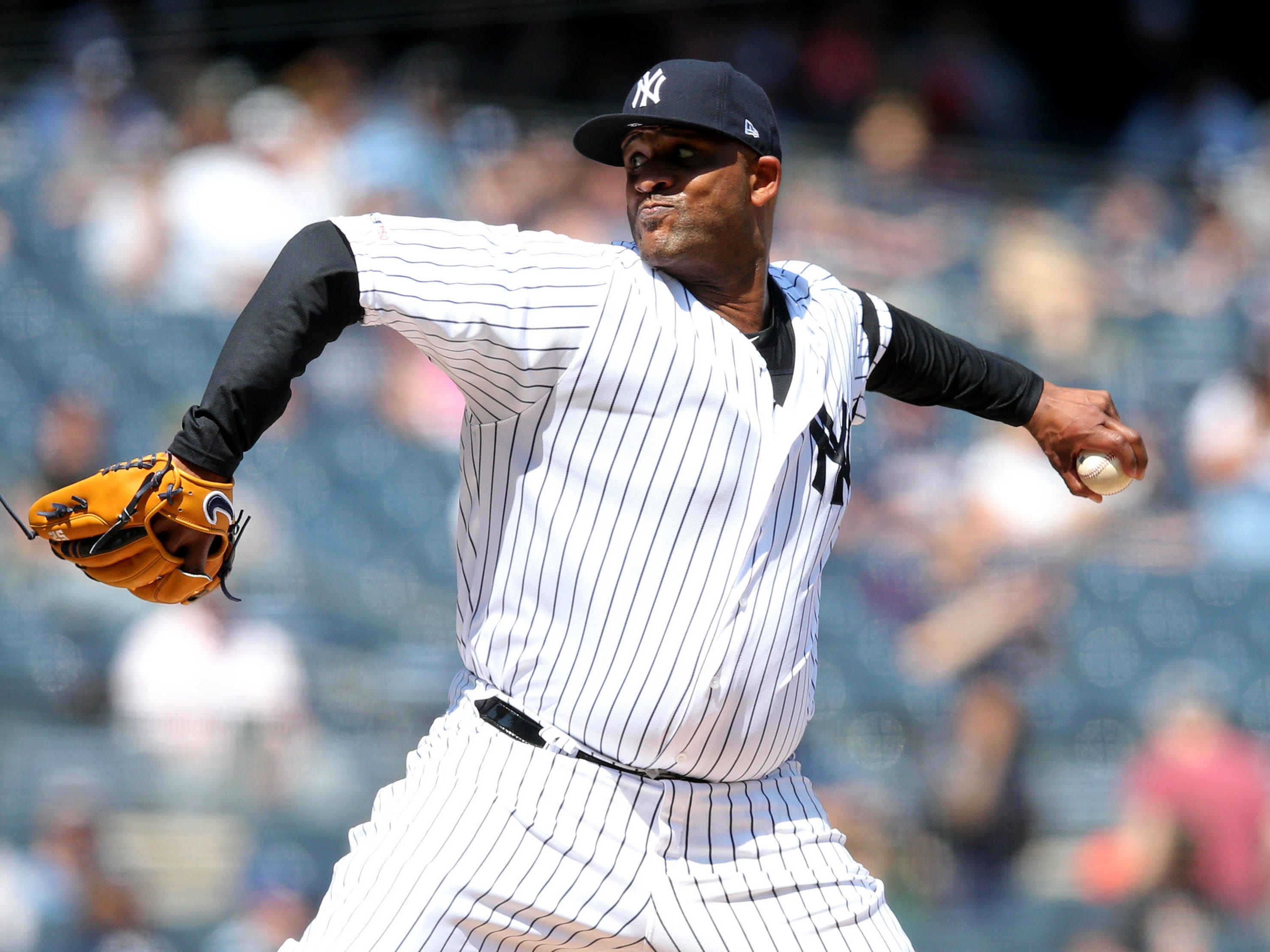 Apr 13, 2019; Bronx, NY, USA; New York Yankees starting pitcher CC Sabathia (52) pitches against the Chicago White Sox during the second inning at Yankee Stadium.