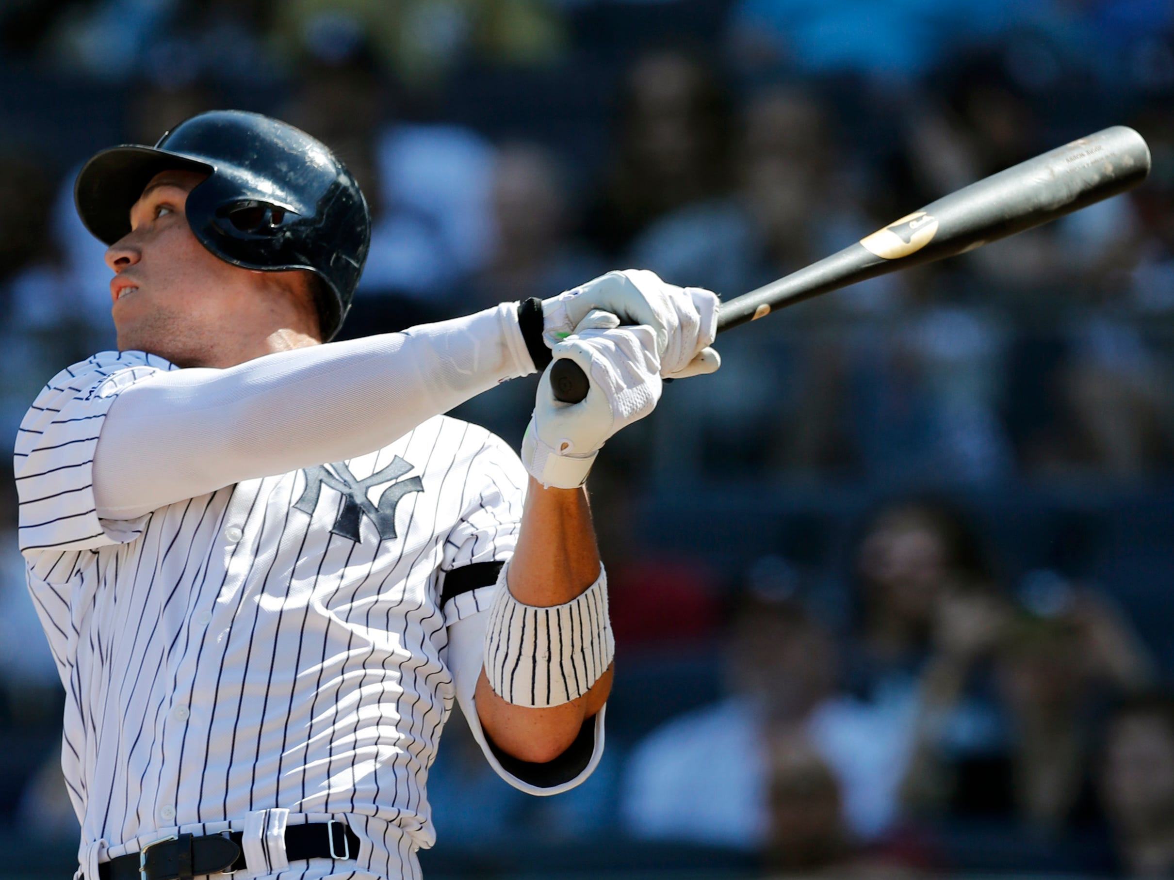 New York Yankees' Aaron Judge follows through on an eighth-inning, solo home run during a baseball game against the Chicago White Sox, Saturday, April 13, 2019, in New York.
