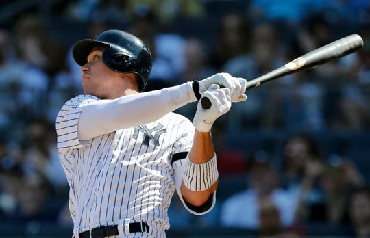 Aaron Judge follows through on an eighth-inning, solo home run against the Chicago White Sox.