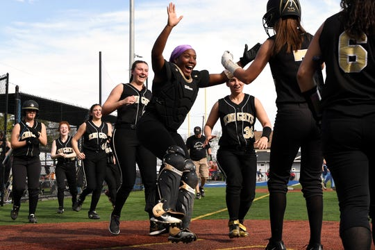 Bergen Tech softball vs. Waldwick in the Donna Ricker Tournament at Wood-Ridge High School on Saturday, April 13, 2019. Bergen Tech celebrates after #7 Julia Murray scored a run.