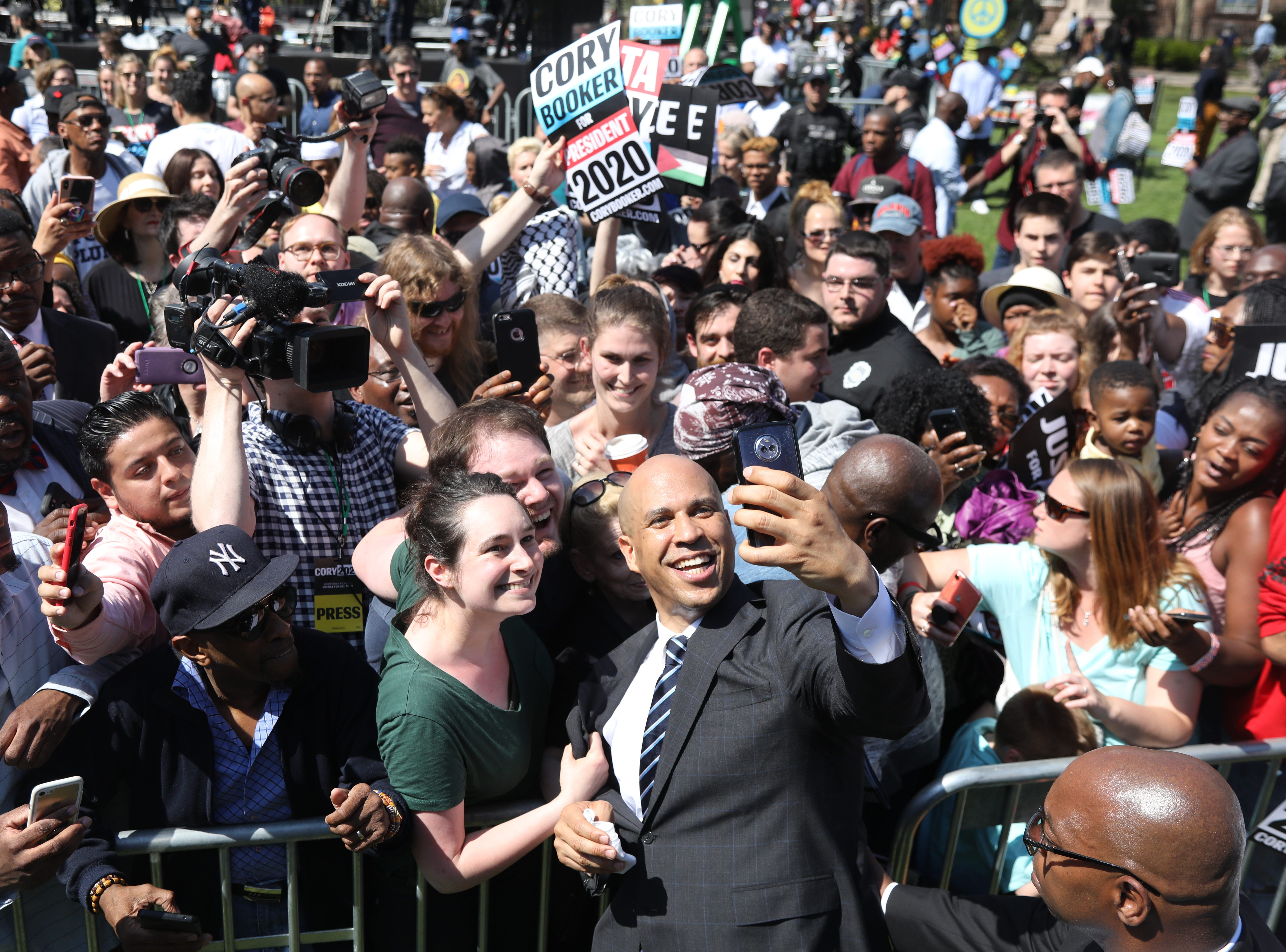 Senator Cory Booker works the rope line, shaking hands and taking selfies, at a rally to kick off the Cory Booker campaign for president that was held at Military Park in Newark on April 13, 2019.