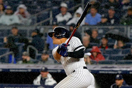 Apr 12, 2019; Bronx, NY, USA; New York Yankees third baseman Gio Urshela (29) doubles against the Chicago White Sox during the second inning at Yankee Stadium.