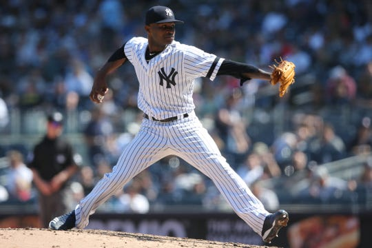 Apr 13, 2019; Bronx, NY, USA; New York Yankees relief pitcher Domingo German (55) pitches against the Chicago White Sox during the seventh inning at Yankee Stadium.