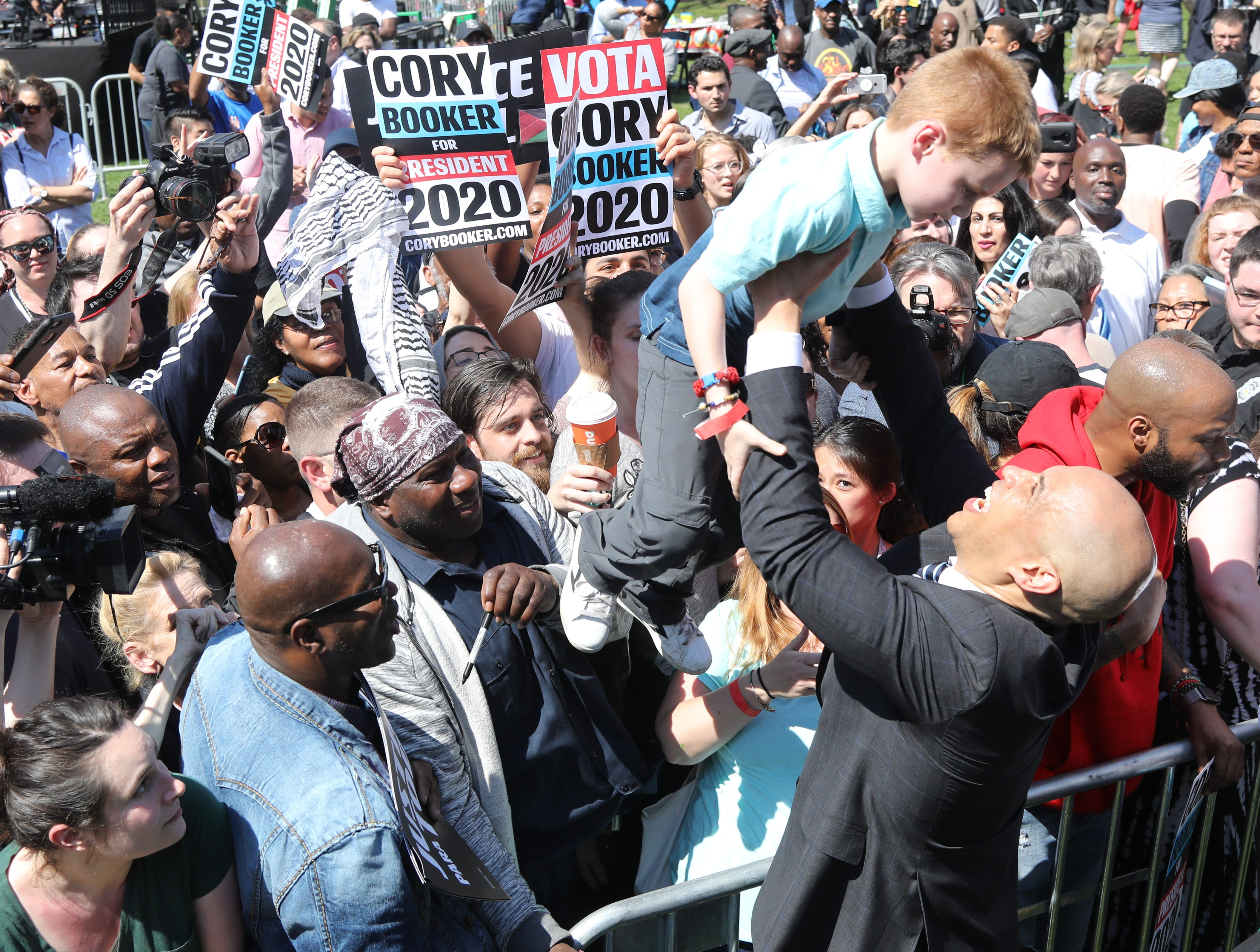 Senator Cory Booker works the rope line, shaking hands, taking selfies and meeting kids at a rally to kick off the Cory Booker campaign for president that was held at Military Park in Newark on April 13, 2019.