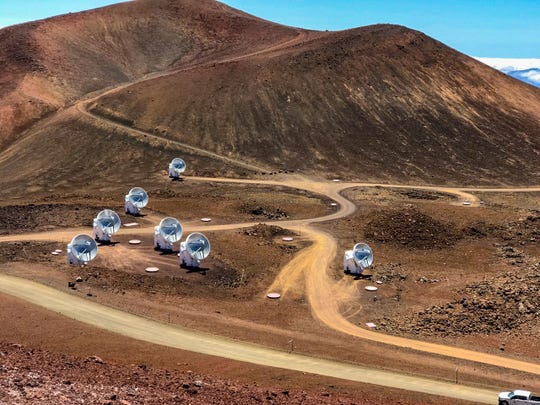 This April 4, 2019, photo, provided by Maunakea Observatories shows the Submillimeter Array, part of the Event Horizon Telescope network on the summit of Mauna Kea, Hawaii. Scientists on Wednesday, April 10, revealed the first image ever made of a black hole using these telescopes.