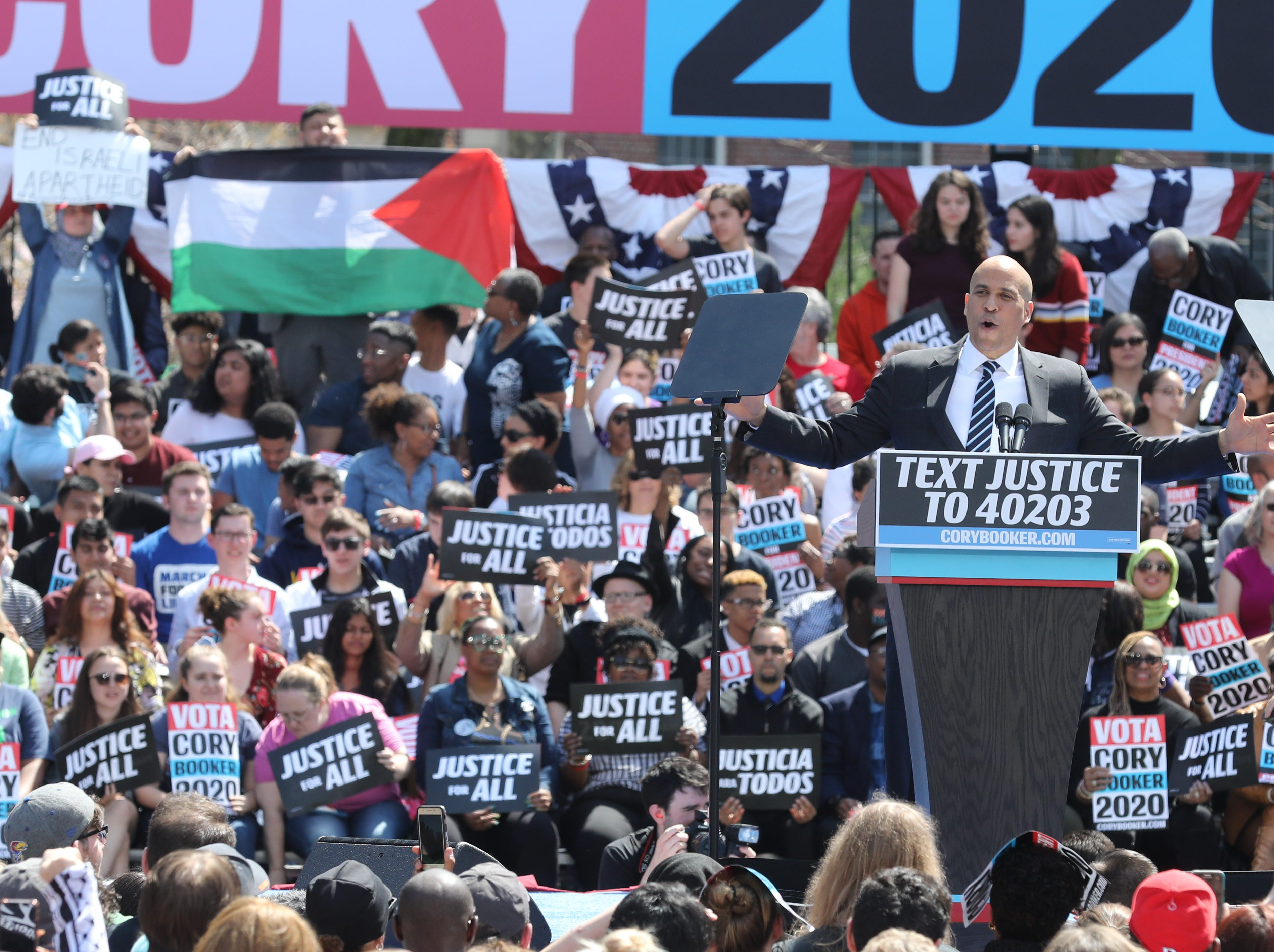 Protesters chanting Free Palestine hold a Palestinian flag during Senator and presidential candidate Cory Booker's address to supporters at a rally to kick off the Cory Booker campaign for president that was held at Military Park in Newark on April 13, 2019.
