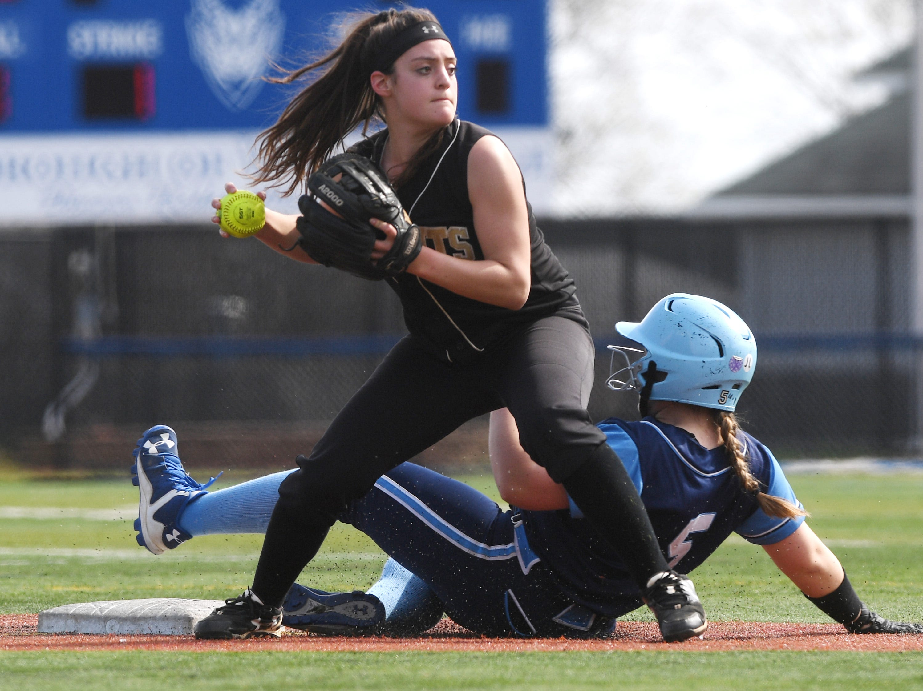 Bergen Tech softball vs. Waldwick in the Donna Ricker Tournament at Wood-Ridge High School on Saturday, April 13, 2019. BT #8 Gianna Sarlo gets W #5 Kacie Centineo out at second.