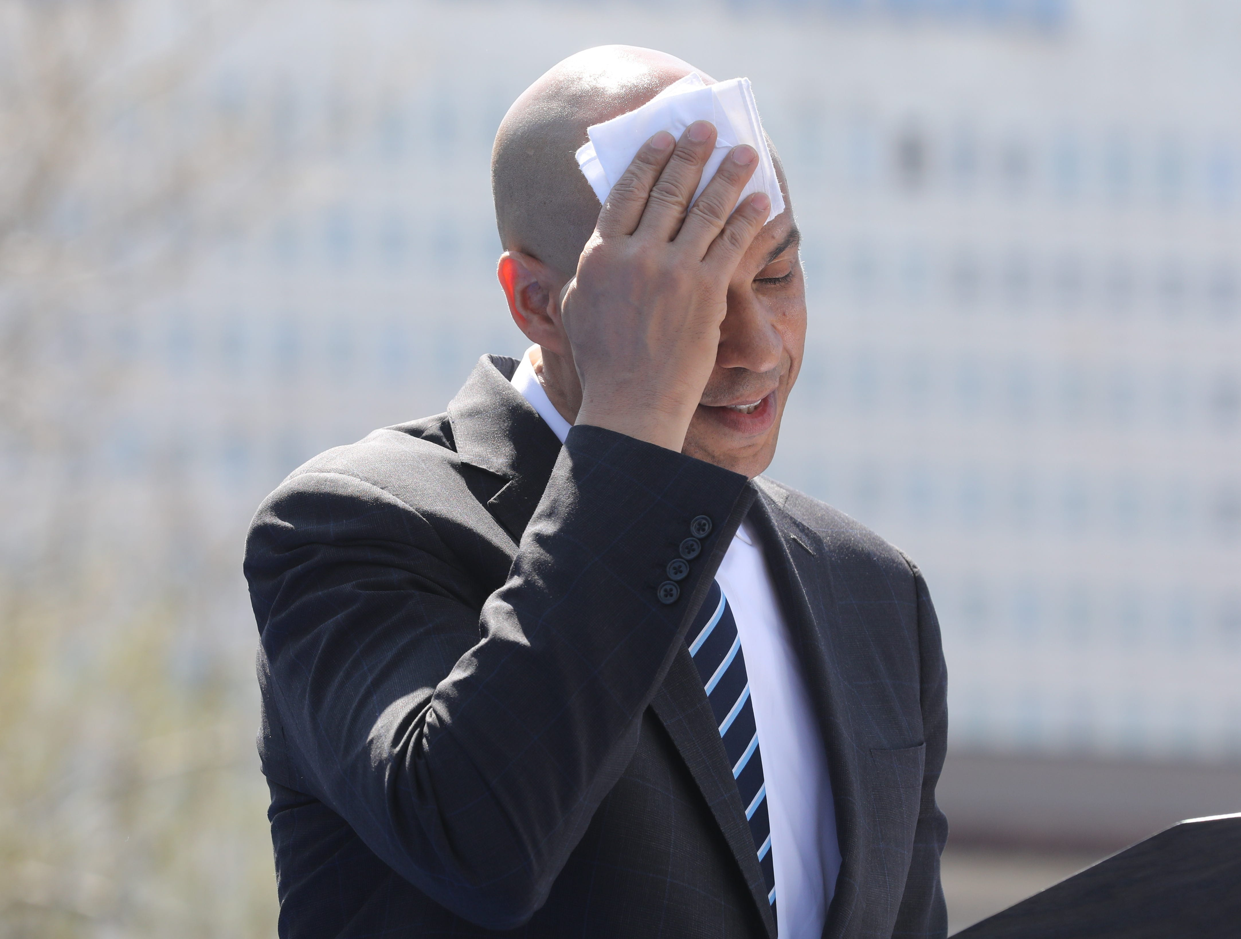Senator Cory Booker wipes his forehead as he addresses supporters at a rally to kick off the Cory Booker campaign for president that was held at Military Park in Newark on April 13, 2019.