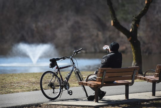 A man takes a break from his bicycle ride to drink some water on a recent sunny day in the Otto C. Pehle Area of Saddle River County Park in Saddle Brook.