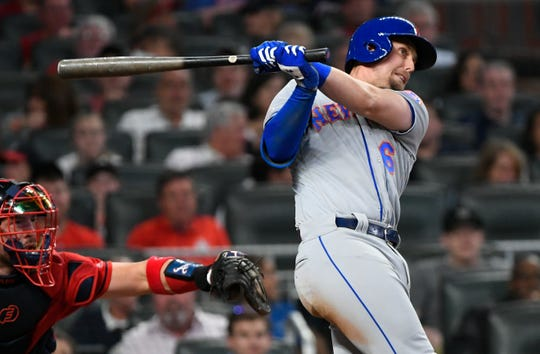 New York Mets' Jeff McNeil watches two-run double to right field during the fourth inning of a baseball game against the Atlanta Braves, Friday, April 12, 2019, in Atlanta.