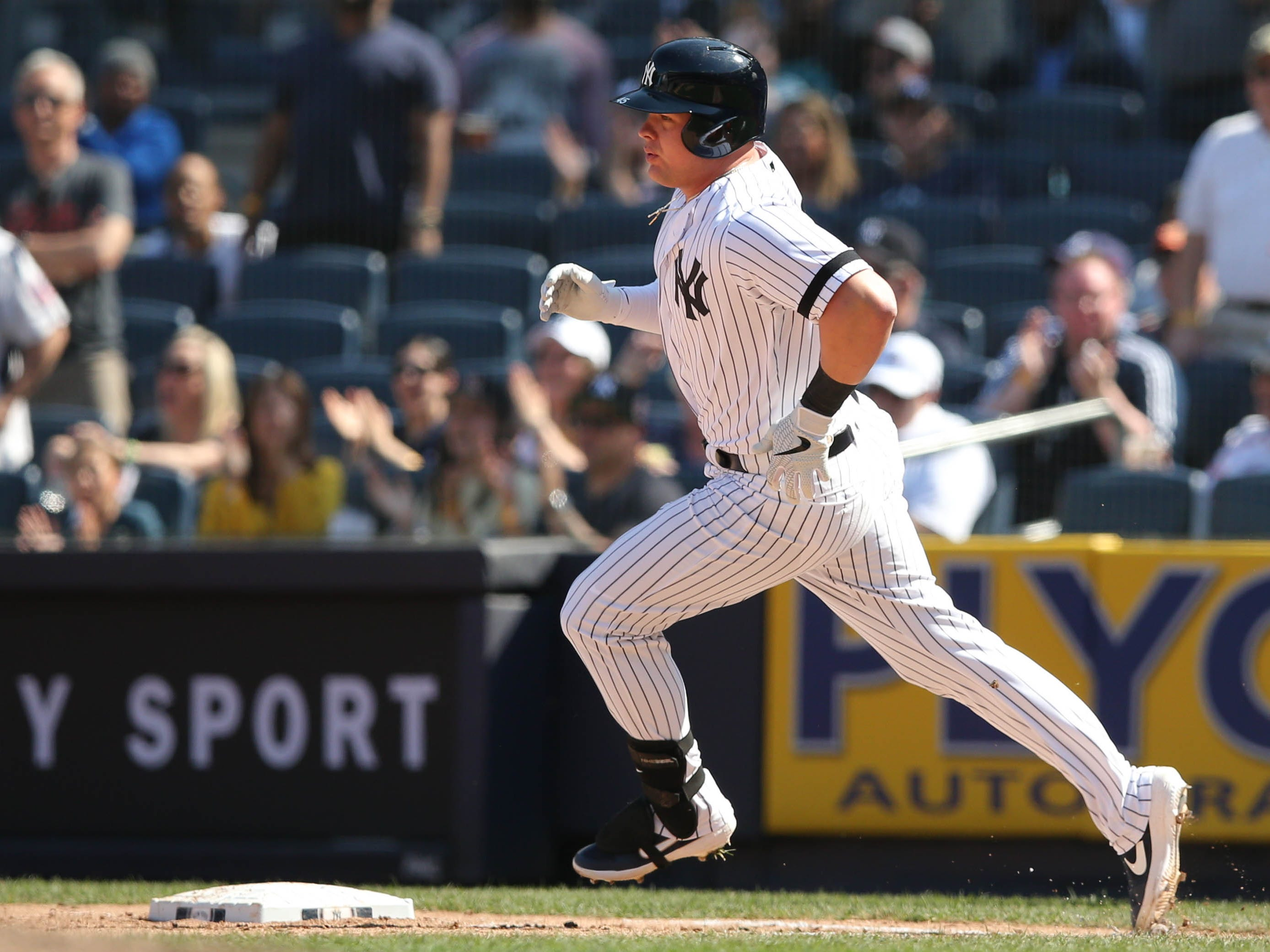 Apr 13, 2019; Bronx, NY, USA; New York Yankees first baseman Luke Voit (45) takes a wide turn at first after hitting an RBI single against the Chicago White Sox during the seventh inning at Yankee Stadium.