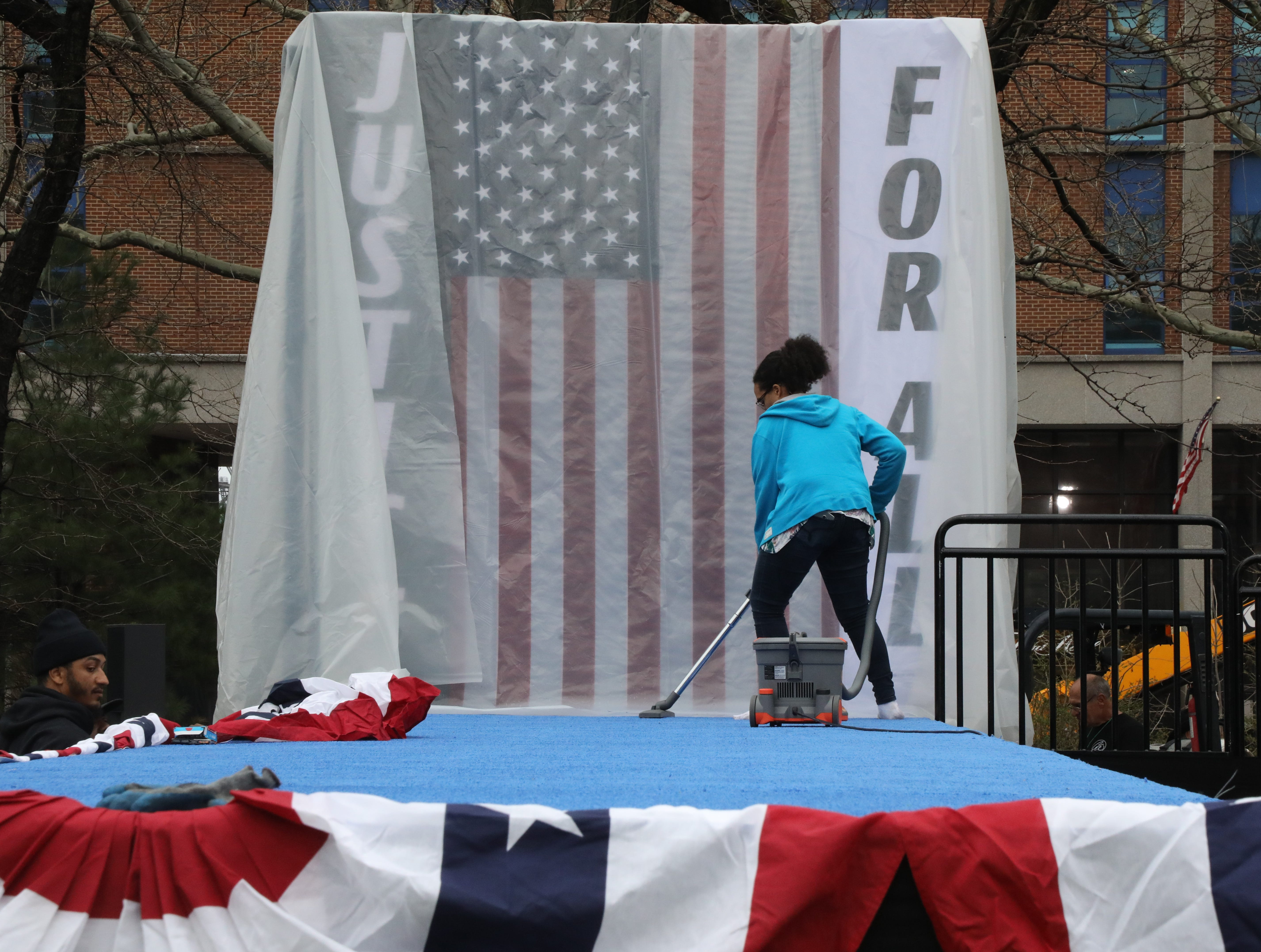 Campaign staff vacuum the stage that Cory Booker will enter to start a rally to kick off the Cory Booker campaign for president was held at Military Park in Newark on April 13, 2019.