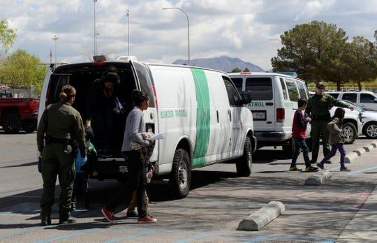 Border Patrol vans drop off migrants at Meerscheidt Recreation Center on Saturday morning, April 13, 2019.
