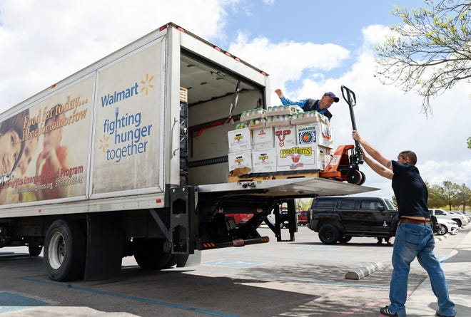 Staff from Casa de Peregrinos food pantry unload food for migrants at Meerscheidt Recreation Center on Saturday, April 13, 2019.