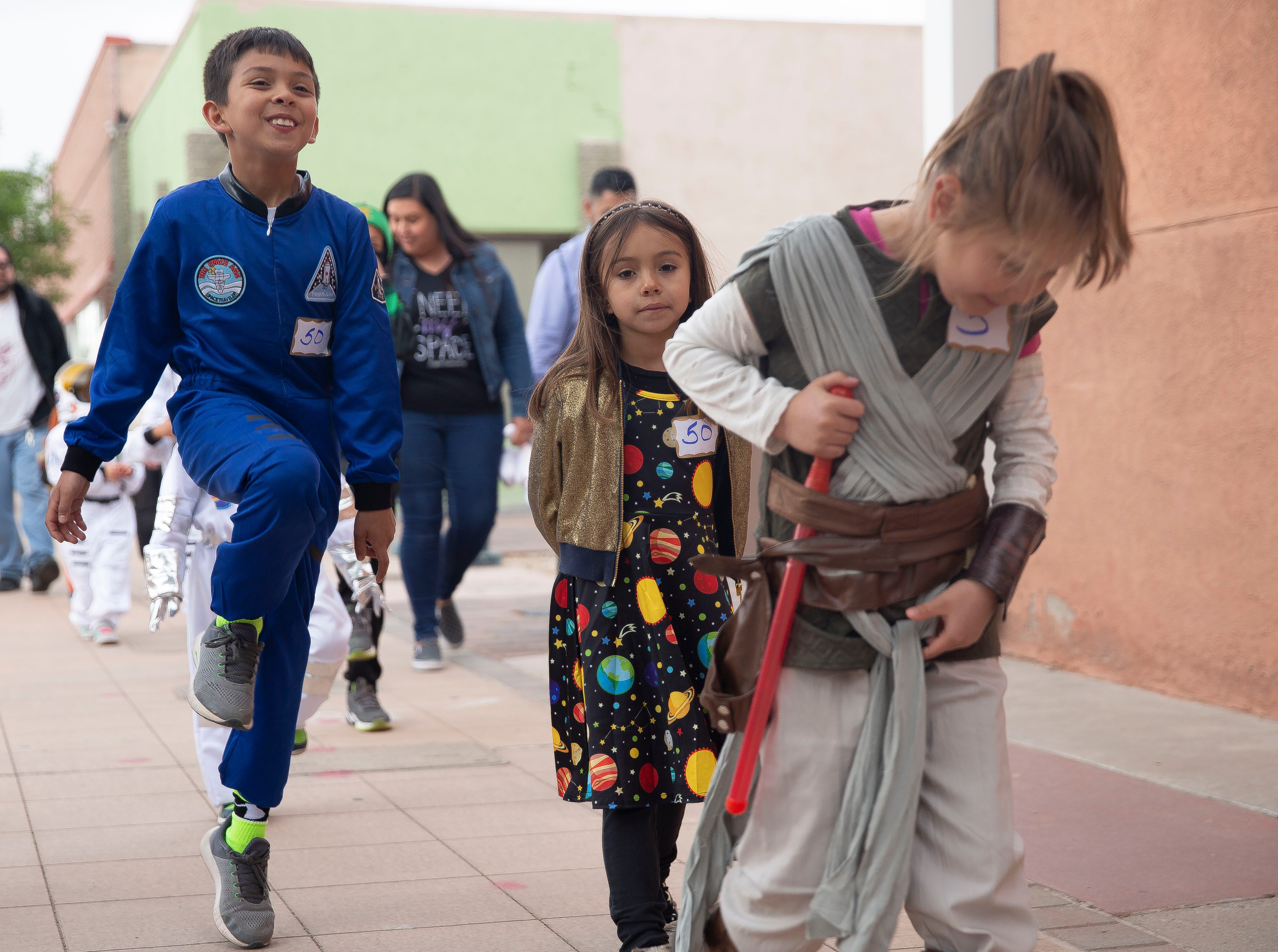 Children participate in the second Space Walk on Friday April 12, 2019, in downtown Las Cruces. The kids are pretending to walk in zero gravity.