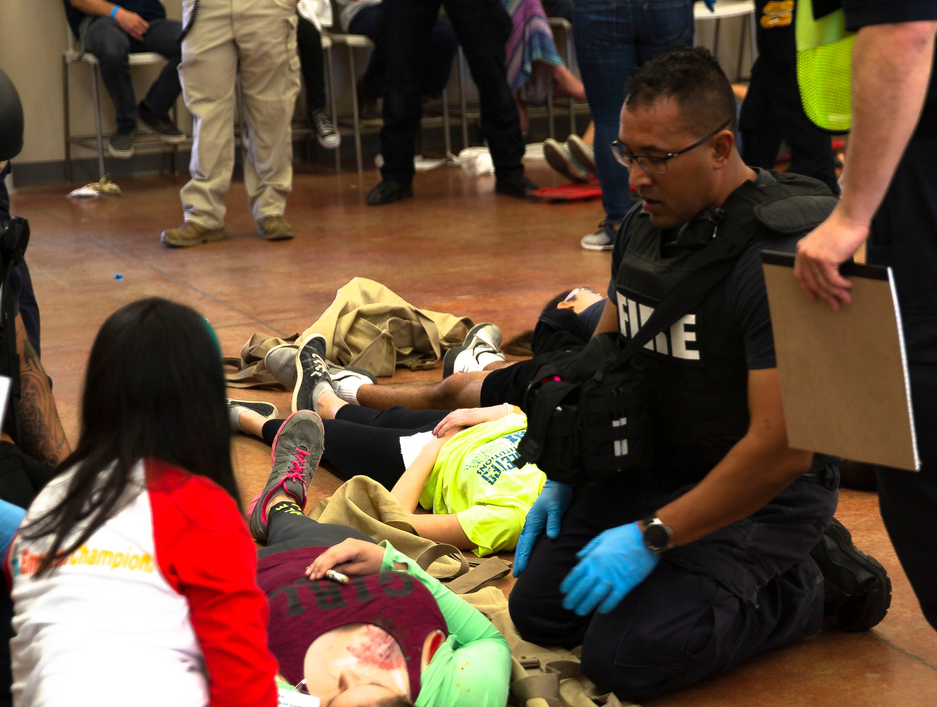 "A fireman attends to an ""injured"" student Saturday, April 13, 2019, during an active shooter training exercise at Arrowhead Park Early College High School. About 20 agencies participated in Saturday's training."