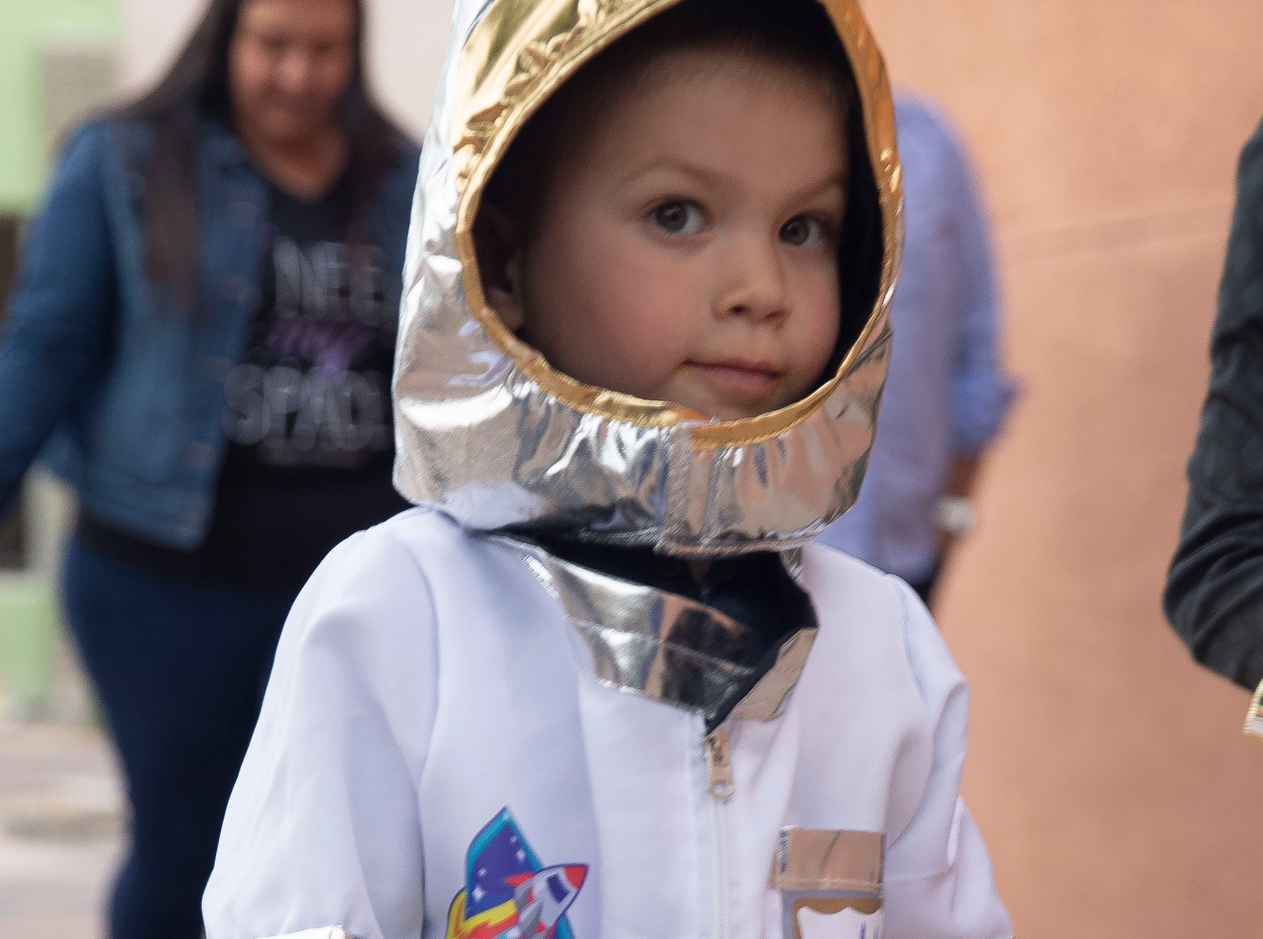A young astronaut pretends to go on a space walk Friday, April 12, 2019 during the Space Walk in Las Cruces. The Space Walk is part of the Las Cruces Space Festival, and is aimed at getting children excited about the space industry.