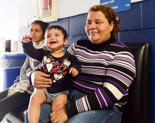 A Honduran mother and her son shortly  after their arrival at Meerscheidt Recreation Center on Saturday, April 13, 2019.