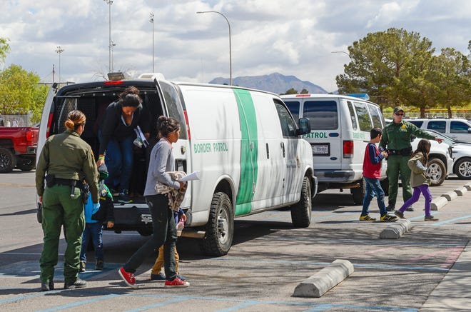 Border Patrol vans drop off migrants at Meerscheidt Recreation Center on Saturday morning, April 13, 2019.