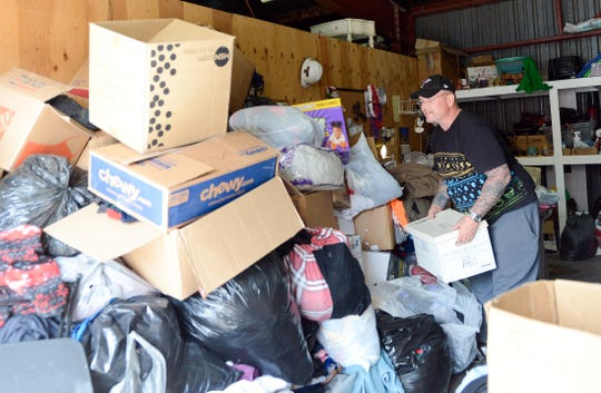 Ray Marshall, operations manager for donations at the Gospel Rescue Mission sorts through donations for migrants the shelter received on Saturday, April 13, 2019.