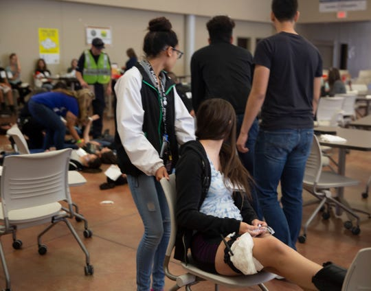 "A young volunteer is treated for an ""injury"" Saturday, April 13, 2019, at Arrowhead Park Early College High School in Las Cruces, during an active shooter training exercise."
