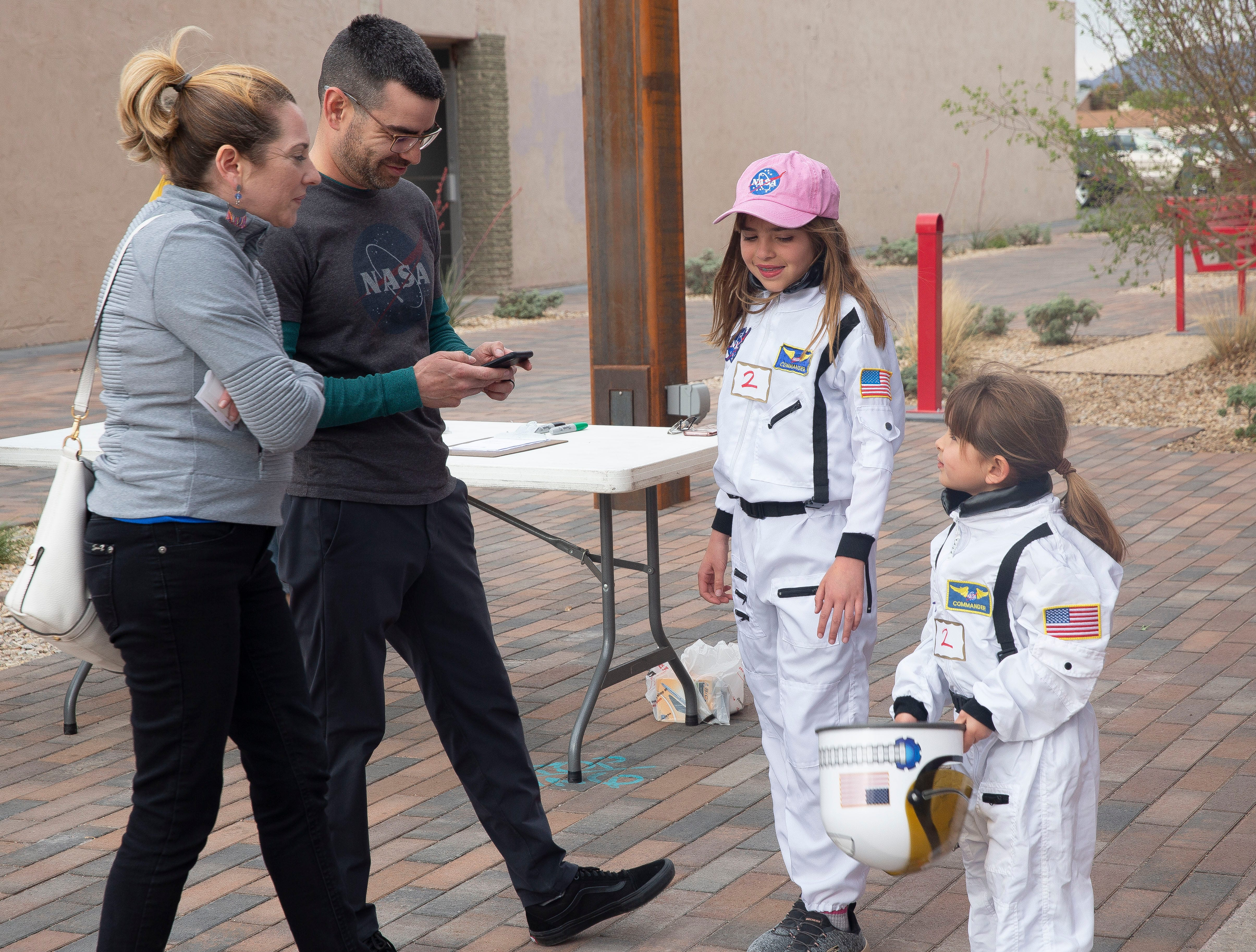 "Lucia Tellez, 10, said she wants to be an astrophysicist when she grows up. ""I just love space,"" she said. The Tellez family — from left, Celine, Dominic, Lucia, and Sophia, 5 — attended the Las Cruces Space Walk on Friday, April 12, 2019, at the Plaza de Las Cruces"