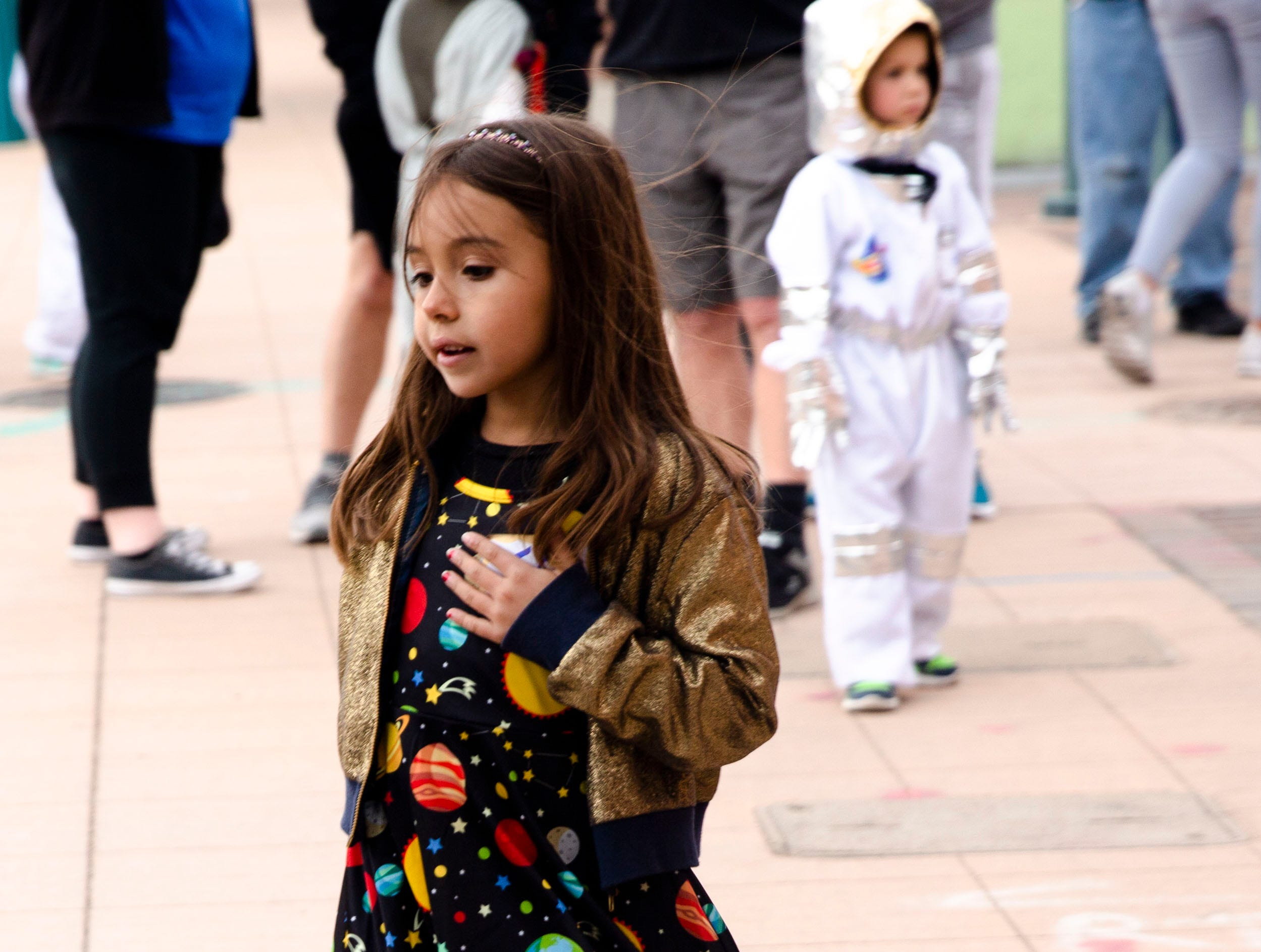 Milana Hernandez, 7, dressed as the solar system, for this year's Space Walk, held Friday, April 12, 2019, in downtown Las Cruces.