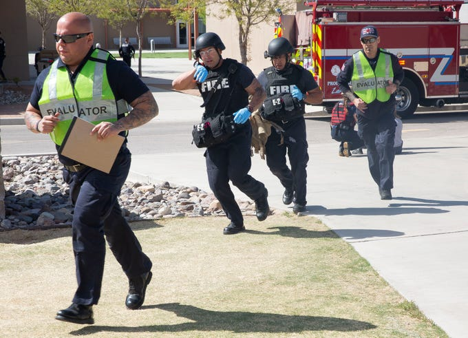 "Fire crews rush to assist the ""injured,"" Saturday, April 13, 2019, during an active shooter training at Arrowhead Park Early College High School. About 20 area agencies participated in the training exercise."