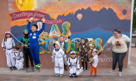 Joaquin Hernandez, 10, jumps with enthusiasm during the second Space Walk Friday, April 12, 2019, in Las Cruces. Hernandez, dressed as an astronaut, and his sister Milana, 7, dressed as the solar system, won first prize in the event's costume contest.